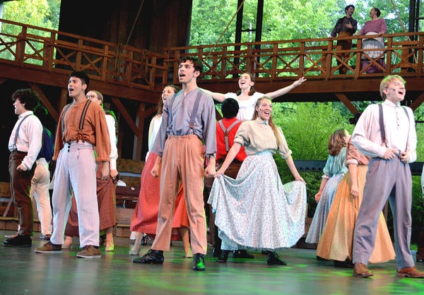 Actors fill the stage with song and dance in one of the many musical numbers of the new play